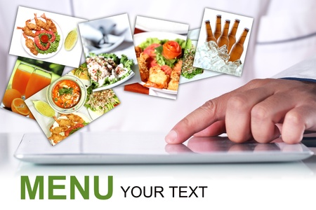 Chef is using a digital tablet, With a pictures Food items photo