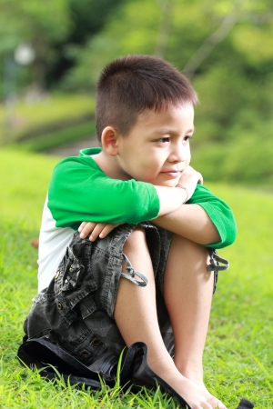 Asian boy relax in the park photo