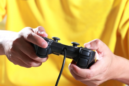Play a computer game with joypad photo