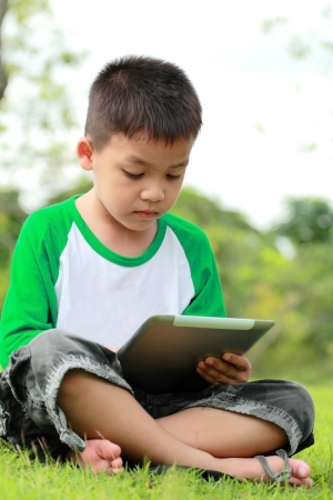 Boy using digital tablet photo