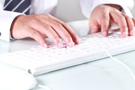 Man is typing computer keyboard photo