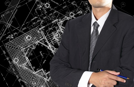 Cropped view of Architect standing in front of Architectural background Stock Photo - 14567736