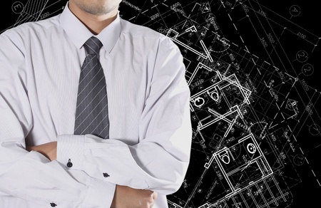 Cropped view of Businessman standing in front of Architectural background photo