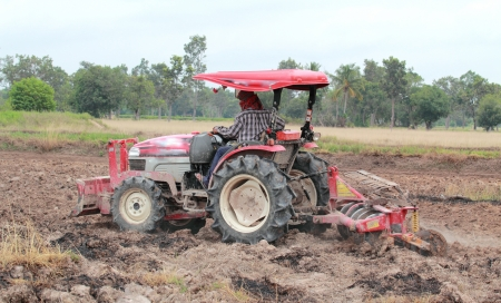 Tractor in rural agricultural areas photo