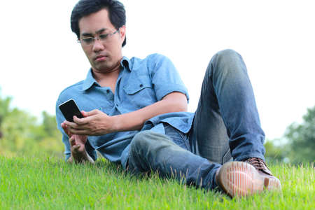 Man Using smart phone in the park photo