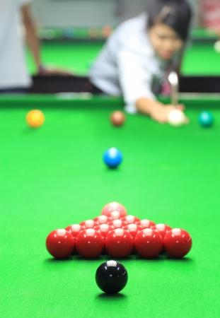 Girl play snooker photo