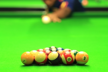 Man play Billiards photo