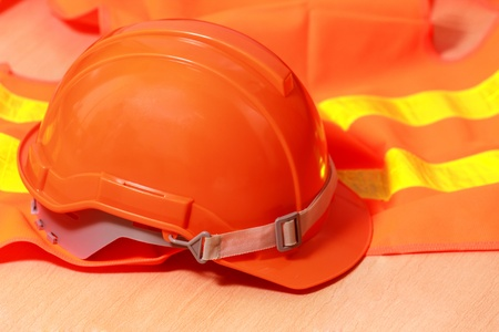 Protection helmet and orange vest Stock Photo - 14753915