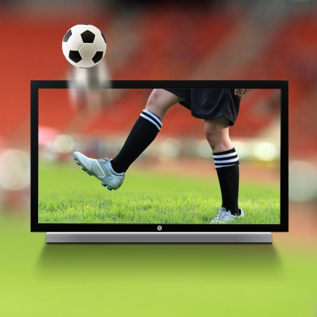 flat panel monitor: Live soccer on TV Stock Photo