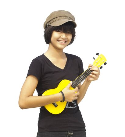 Little girl playing guitar, look to the camera and smile, On white background photo