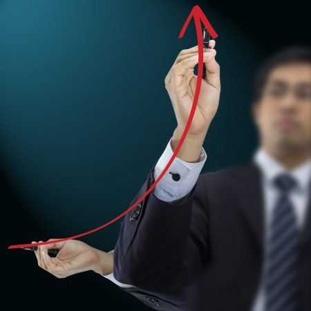 Businessman drawing red arrow photo