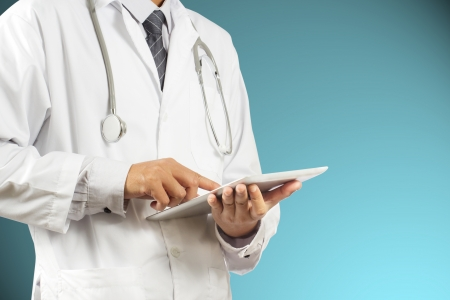 doctor surgeon: Doctor using a digital tablet