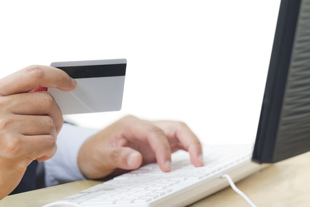 Business man paying online with his credit card Stock Photo - 16511010