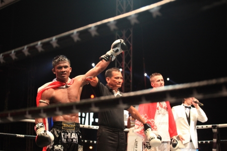 BANGKOK, THAILAND- DECEMBER 16 : Buakaw Por. Pramuk (Thailand) wins on points vs Vitaly Hurkou (Belarus) in THAI FIGHT 2012, 70 KG. ( Final Round ) on December 16, 2012 at King Chulalongkorn Monument Square, Bangkok, Thailand