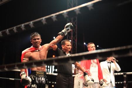 vitaly: BANGKOK, THAILAND- DECEMBER 16 : Buakaw Por. Pramuk (Thailand) wins on points vs Vitaly Hurkou (Belarus) in THAI FIGHT 2012, 70 KG. ( Final Round ) on December 16, 2012 at King Chulalongkorn Monument Square, Bangkok, Thailand