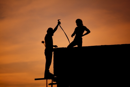 Silhouettes of worker welder photo