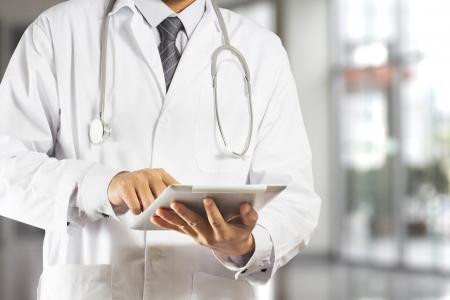 medical practice: Doctor using a digital tablet