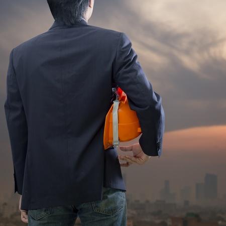 Engineer or architect looking ahead at sunrise photo