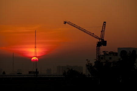 Crane in construction site at sunset photo
