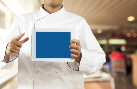 Chef showing a digital tablet in the restaurant Stock Photo