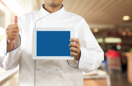 restaurant staff: Chef showing a digital tablet in the restaurant Stock Photo
