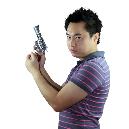 Man holding gun on white background Stock Photo - 17381281