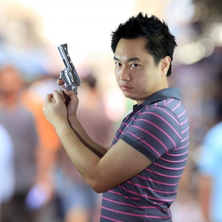 Man holding gun Stock Photo - 17381371