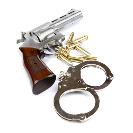 Gun, bullets and handcuffs isolated on white background Stock Photo - 17466557