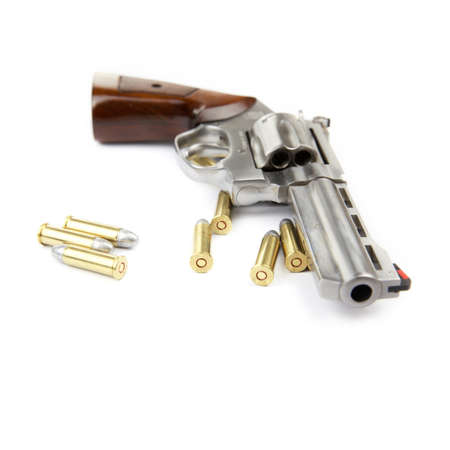 Gun and bullets on white background Stock Photo - 17466567