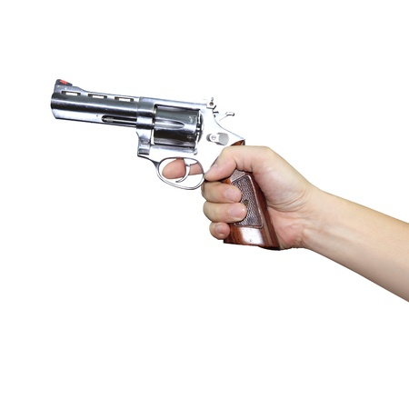 Hand holding a gun on white background Stock Photo - 17466538