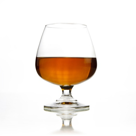 Whiskey in glass on white background