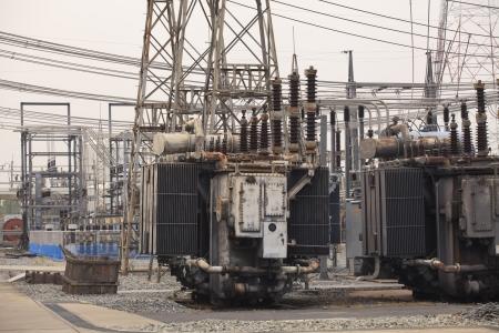 transformator:  Electrical power transformer in high voltage substation