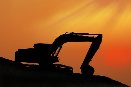 Silhouetted Digging Machine Stock Photo - 18236126
