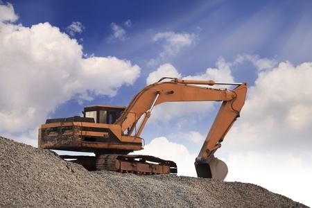 Excavator machine on a blue sky photo