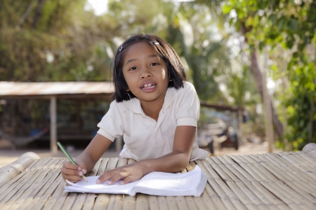 Student little asian girl, countryside in Thailand photo