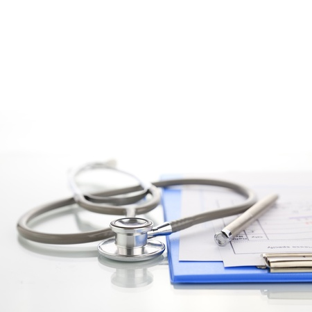 Stethoscope with blue medical clipboard Stock Photo