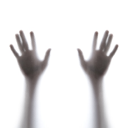 Shadow hands of the Man behind frosted glass Stock Photo