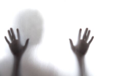 Shadow of men standing behind frosted glass Stock Photo - 18587802