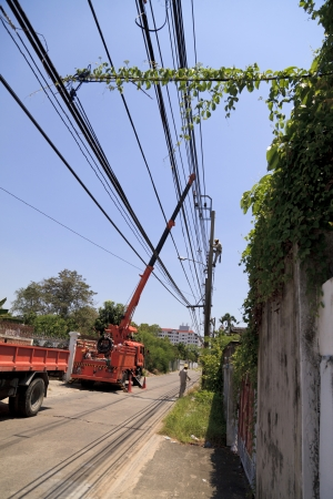 Technician repairing on electrical post photo