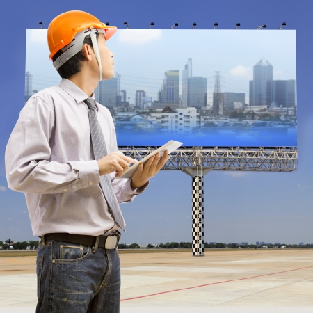 Engineers and architects using digital tablet at working photo