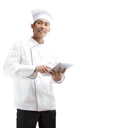 Chef using digital tablet on a white background with clipping path  photo