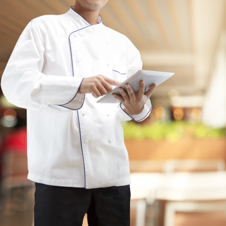 Chef using digital tablet in restaurants photo