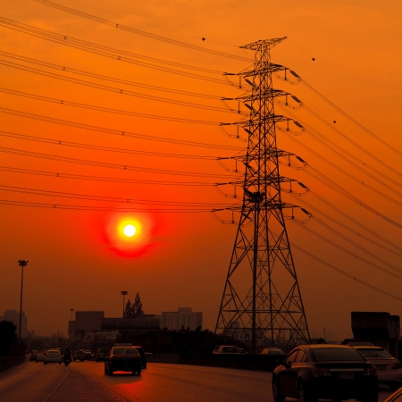 Silhouette of high voltage towers at sunset Stock Photo - 18921789