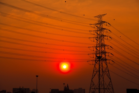 Silhouette of high voltage towers at sunset photo