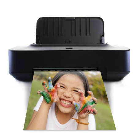 Printer and picture and Little girl with hands in colorful paint photo