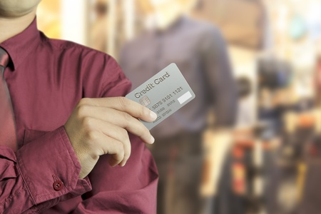 Cropped view of Businessman hand holding credit card in Shopping mall Stock Photo - 19027604