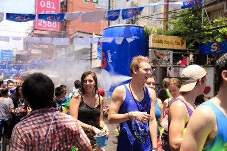 BANGKOK, THAILAND - APRIL 13  Unidentified Thai and International people enjoy in  Bangkok Songkran Festival 2013  Thailand new year   at Khao san Road on April 13, 2013 in Bangkok, Thailand  Stock Photo - 19107672
