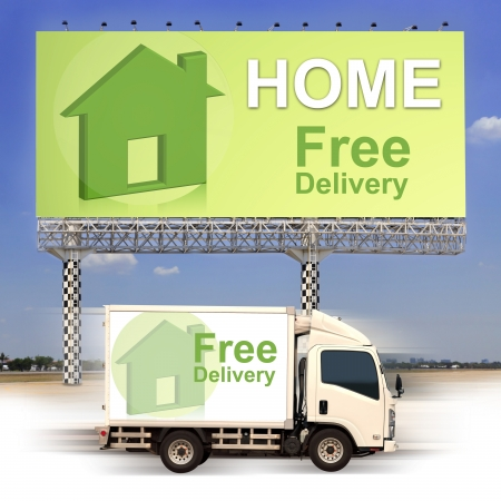 White van with Free delivery and large outdoor billboard