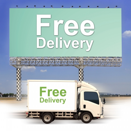 White van with Free delivery and large outdoor billboard photo