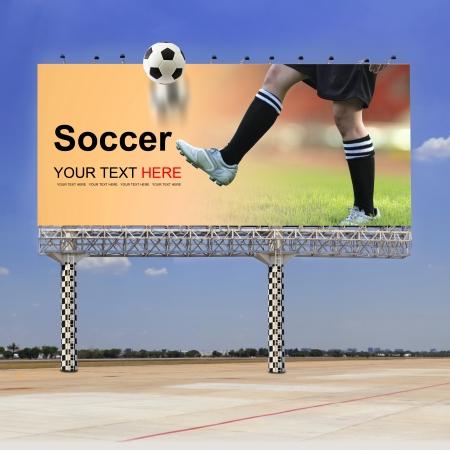 football match lawns: Soccer field, Soccer player on outdoor billboard